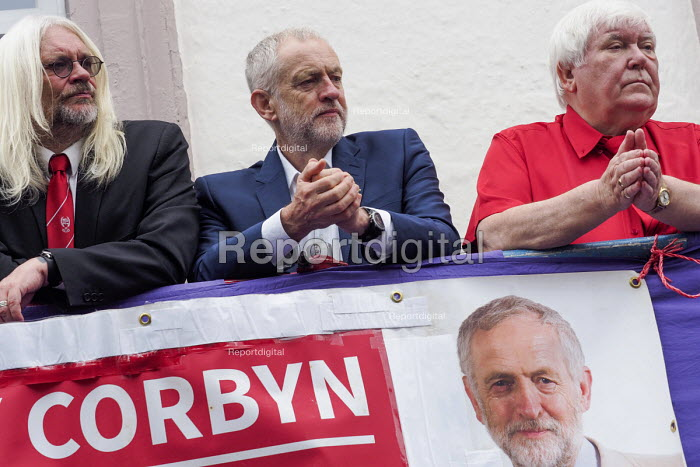 Durham Miners Gala 2016 Tosh McDonald ASLEF, Jeremy Corbyn and Dave Hopper DMA watching the procession from the balcony of the County Hotel, Durham, Co' Durham - Mark Pinder - 2016-07-09