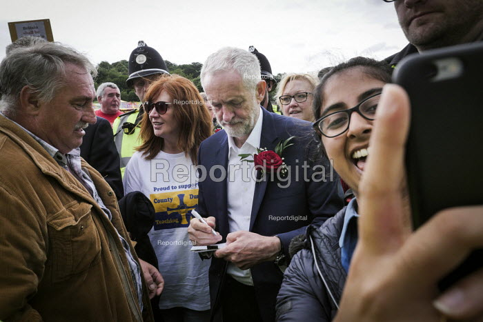 Jeremy Corbyn signing an autograph for supporters after his speech, Durham Miners Gala 2016, Co Durham - Mark Pinder - 2016-07-09