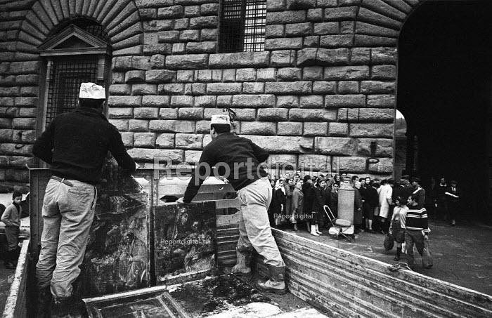 Rescuing artworks from the Florence Floods, Italy, 1966. The floods in Florence in early November 1966 were the worst in over five hundred years and resulted in the loss of over 100 Florentine lives as well as damage to thousands of cultural artefacts, including ancients books, paintings and sculptures. Damaged paintings on the back of a truck en route from the Ufizzi Gallery to the Palazzo Pitti Gallery where they will be kept at humidified temperatures for many months prior to restoration by experts. - Romano Cagnoni - 1966-11-11