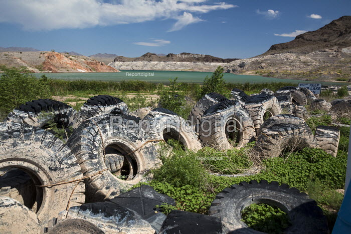 Las Vegas, Nevada drought. The water level in Lake Mead has fallen 150 feet and is now at 37% of capacity due to drought in the West. Truck tires were a breakwater for the Echo Bay marina which is now on dry land. - Jim West - 2016-06-22