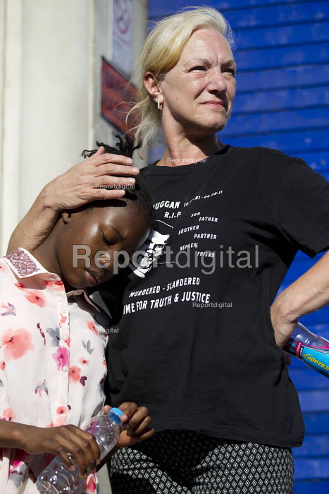 Carol Duggan with the daughter of Mark Duggan. Five years since the Tottenham Riots the Mark Duggan Justice Campaign Day of Action, Remembrance and Community Healing protest from Broadwater Farm to Tottenham Police Station, North London. - Jess Hurd - 2016-08-06