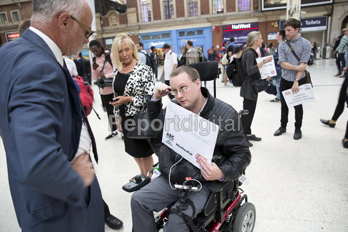 Disabled commuter campaigning for guards talking to Crispin Blunt MP. Southern Rail passengers take a petition calling for fair fares and compensation to the Department of Transport, Westminster, London. - Jess Hurd - 2016-08-11