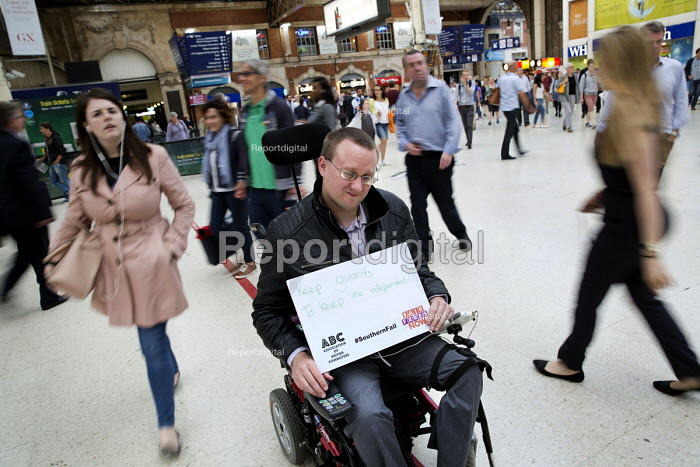 Disabled commuter campaigning for guards. Southern Rail passengers take a petition calling for fair fares and compensation to the Department of Transport, Westminster, Victoria Station London - Jess Hurd - 2016-08-11