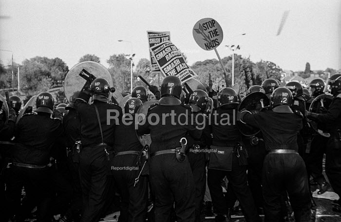 Riot police baton charge Anti Nazi protest against the BNP HQ in Welling, Kent - Paul Mattsson - 1993-10-16