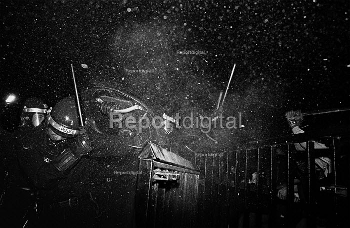 Anti Criminal Justice Bill protest, protester throwing a large full cider bottle at riot Police, Hyde Park London - Paul Mattsson - 1994-10-09