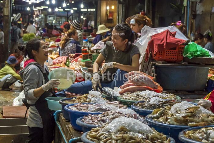 Siem Reap, Cambodia, workers in the market, fishmongers enjoying a joke. - David Bacon - 2015-12-27
