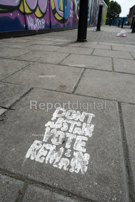 Spray-painted Vote Remain stencil on a pavement in Hackney Wick, London. - Philip Wolmuth - 2016-08-05