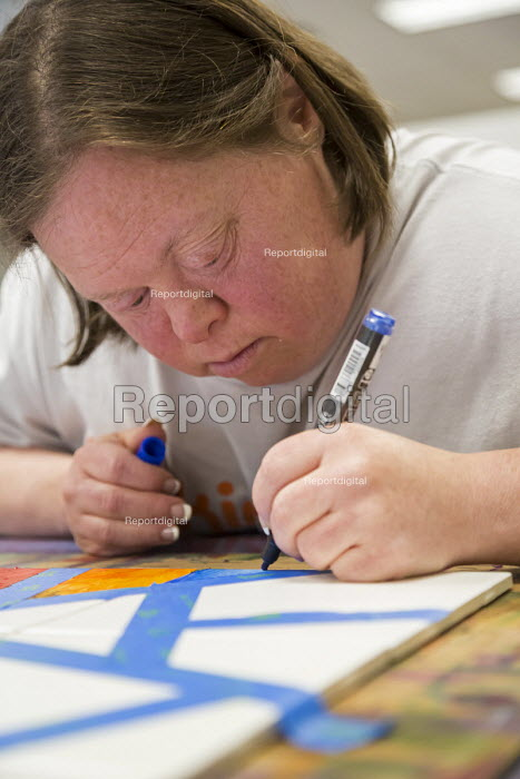 Las Vegas, Nevada - People with intellectual disabilities participate in the Fine Art Program run by the nonprofit Opportunity Village. The artists are paid a commission when their work is sold. - Jim West - 2016-06-30