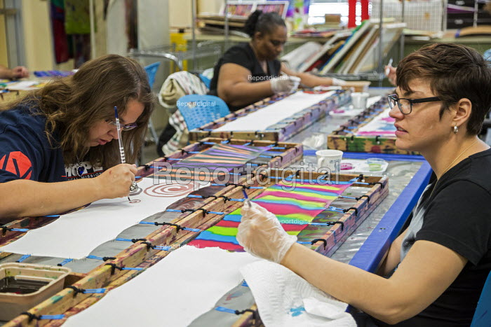 Las Vegas, Nevada - People with intellectual disabilities participate in the Fine Art Program run by the nonprofit Opportunity Village, hand painting silk scarves. The artists are paid a commission when their work is sold. - Jim West - 2016-06-30