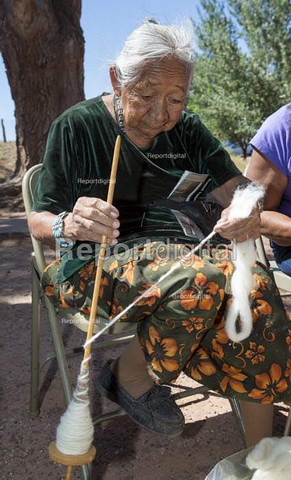 Ganado, Arizona, Navajo Nation, Woman using a Navajo spindle to spin wool into yarn. Wool and Weaving Workshop, Hubbell Trading Post National Historic Site - Jim West - 2016-07-10