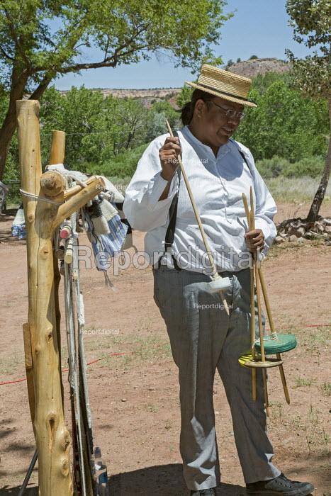 Ganado, Arizona, Navajo Nation, Navajo spindles spinning wool into yarn. Wool and Weaving Workshop, Hubbell Trading Post National Historic Site - Jim West - 2016-07-10