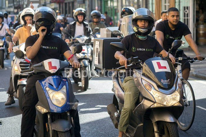 Striking UberEats food delivery couriers protest outside the groups London HQ over pay cuts. - Philip Wolmuth - 2016-08-26