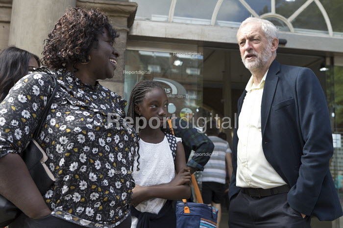 Jeremy Corbyn talking to a mother and children outside the railway station, leadership election rally, Hanley, Stoke on Trent - John Harris - 2016-09-01