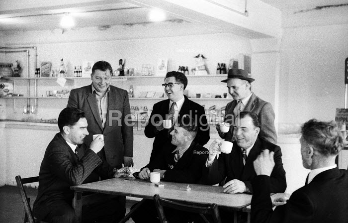 Delegation of miners from the Soviet Union visiting NUM members in the Kent coalfield, 1958. Drinking tea in the pit canteen. - Alan Vines - 1958-10-17