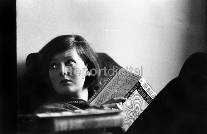 Young woman reading The Bell Jar by Sylvia Plath, 1967 London, when it was first published under her real name. - Patrick Eagar - 1967-04-06