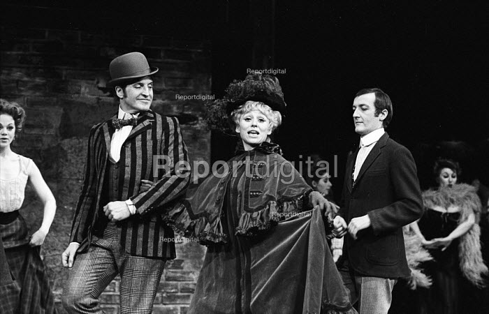 Lead actress Barbara Windsor as Marie Lloyd singing and dancing with actor, Dennis Quilley, Sing A Rude Song, The Greenwich Theatre, 1970. A play based on the life of Marie Lloyd, written by Ned Sherrin and Caryl Brahms. - Patrick Eagar - 1970-02-18