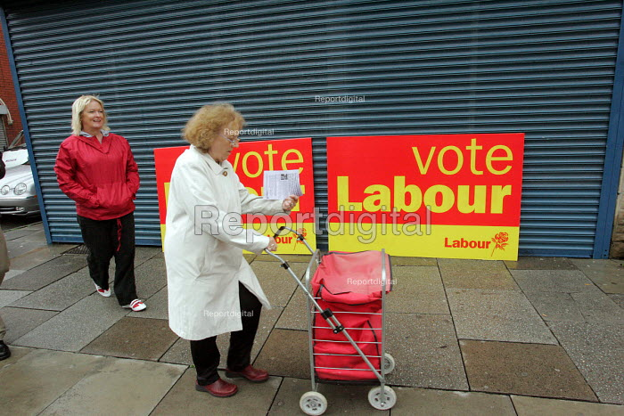 Hartlepool by election. A Hartlepool resident reading an election leaflet exhorting her to vote for the Labour party - Mark Pinder - 2004-08-18