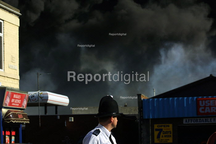 Policeman watching an industrial fire at the Distillex chemical plant, North Shields. 12/4 2002 Residents and workers within a half mile downwind of the accident were evacuated. The plume could be seen for 15 miles. - Mark Pinder - 2002-04-12