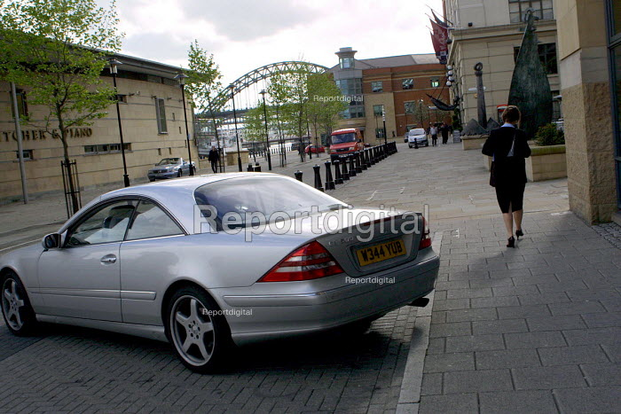 Rather expensive Mercedes Benz car, Quayside, Newcastle Upon Tyne. In the background is the Tyne Bridge which has been the predominant symbol of Tyneside since 1928. - Mark Pinder - 2002-05-22