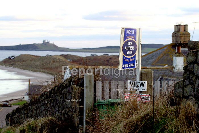 For Sale sign, Low Newton, Northumberland. A small rural village beside the sea. Once a fairly vibrant community which is in decline as residents take advantage of rising property prices and sell up to urban dwellers seeking weekend holiday properties. - Mark Pinder - 2003-01-07