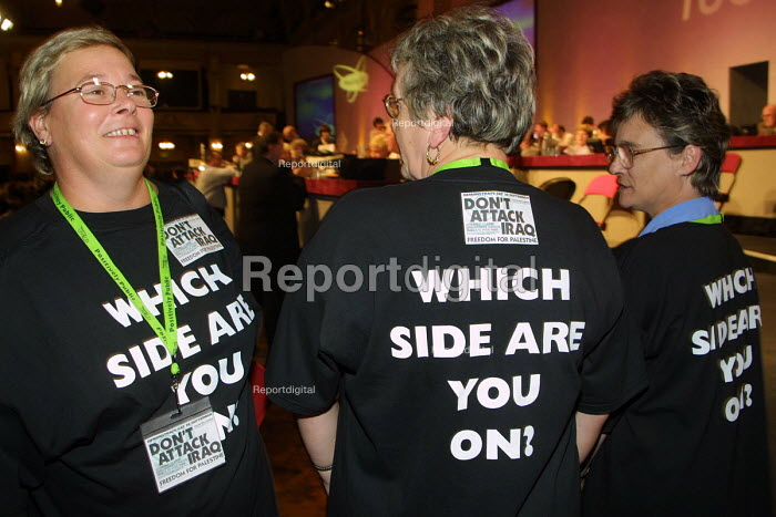 Unison delegates to the 2002 TUC conference sporting pro public service T shirts and anti Iraq war badges prior to the prime minister's speech. 10/9 2002. - Mark Pinder - 2002-09-10
