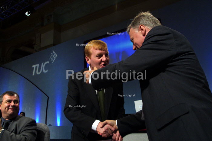 Liberal Democrat leader Charles Kennedy shakes hand with TUC leader John Monks, after his speech to the 2002 TUC conference, Blackpool. 11/9 2002. - Mark Pinder - 2002-09-11