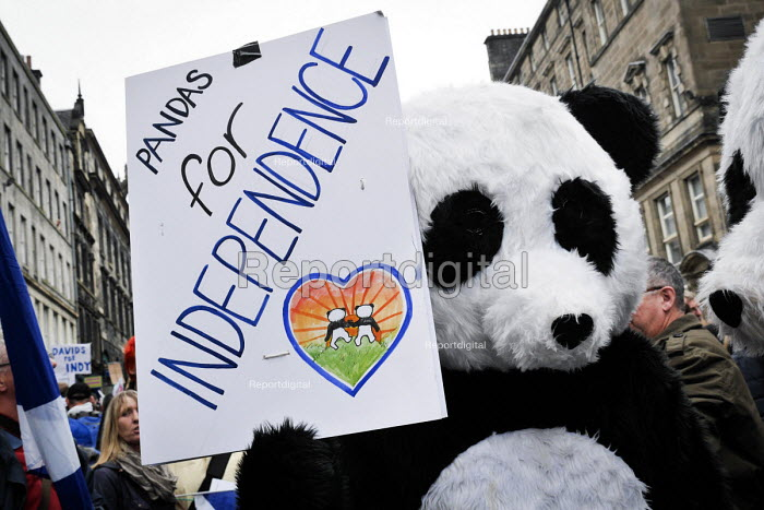 Independence For Scotland march and rally Edinburgh. A pair of pro independence Pandas referencing Tian Tian and her male companion Yang Guang the Edinburgh Zoo Panda's. - Mark Pinder - 2013-09-21