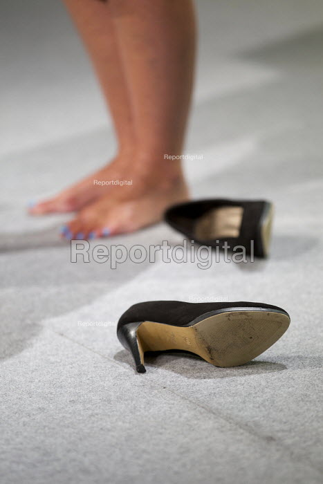Penny Robinson GMB in the suitable footwear debate kicks off her high heels at TUC conference Brighton - Jess Hurd - 2016-09-13