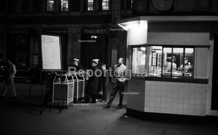 Civilian and military personnel waiting late at night for their trains, Waterloo Station, London 1959 - Alan Vines - 1959-10-23