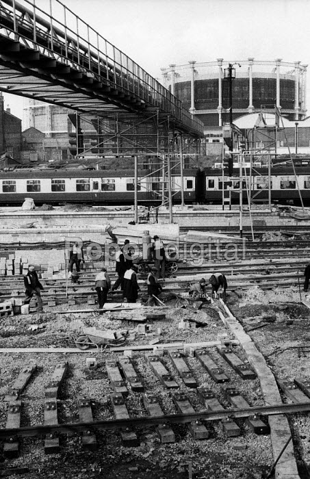 Railway workers working on the electrification of the main train lines heading to the north east, Kings Cross Station, London 1977 - Derek Speirs - 1977-04-12