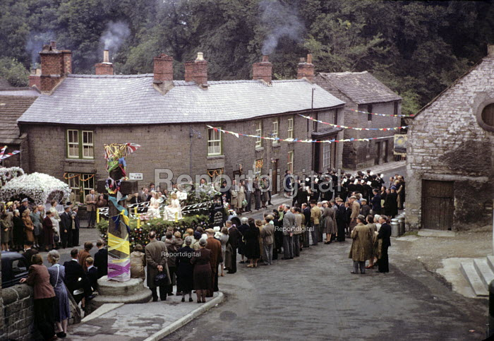 Well Dressing. Parade in 1949 through the small village of Stoney Middleton in the Peak District of Derbyshire to a Well Dressing ceremony. Well Dressing is a Christian tradition developed originally from pagan custom of making sacrifice to the gods of wells and springs to ensure a continued supply of fresh water. - Elisabeth Chat - 1949-08-06