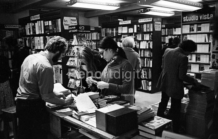 Staff and customers, Foyles Bookshop, Charing Cross Road, London, 1975 - John Sturrock - 1975-11-25