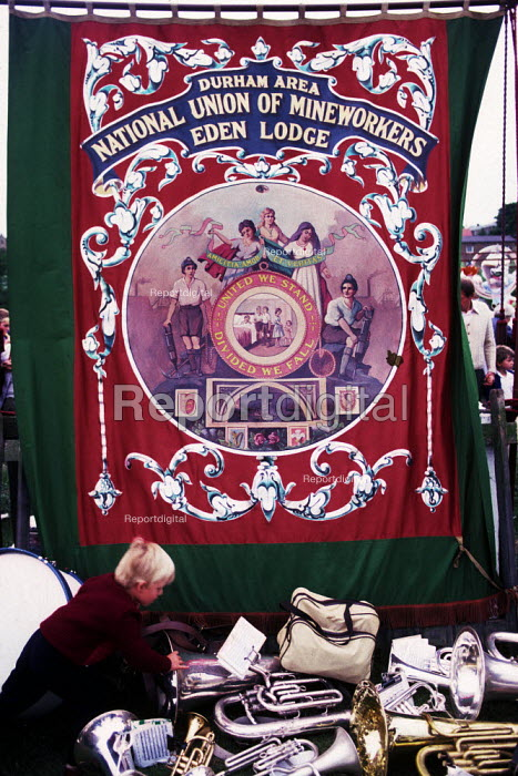 Durham Miners Gala, 1983. Miners and their families march on the 100th Anniversary of the Durham Miners Gala. The Eden Lodge pit banner. - Stefano Cagnoni - 1983-07-16