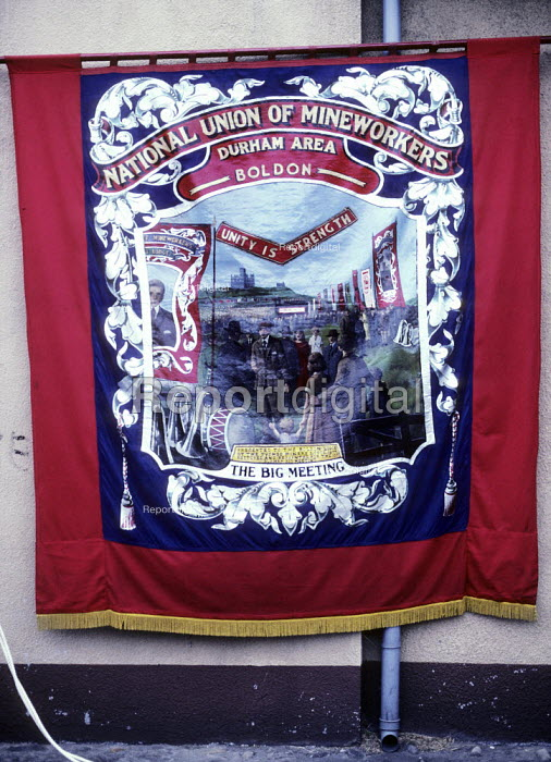 Durham Miners Gala, 1983. Miners march on the 100th Anniversary of the Durham Miners Gala. The Boldon pit banner. - Stefano Cagnoni - 1983-07-16