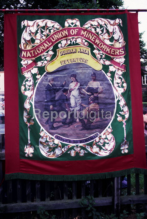 Durham Miners Gala, 1983. Miners march on the 100th Anniversary of the Durham Miners Gala. The Adventure pit banner, one of three pits sunk at Rainton Colliery. - Stefano Cagnoni - 1983-07-16