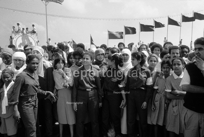 Demonstration in support of Muammar Gaddafi, Tripoli 1984 on the 15th Anniversary of the coup that put him in control of Libya, later renaming it the Socialist Peoples Libyan Arab Jamahiriya. Women soldiers mingling with the mainly female civilian population - Stefano Cagnoni - 1984-09-01