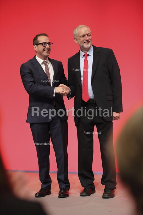 Jeremy Corbyn shaking hands with Owen Smith Labour Party leadership announcement. Liverpool. - Jess Hurd - 2016-09-24