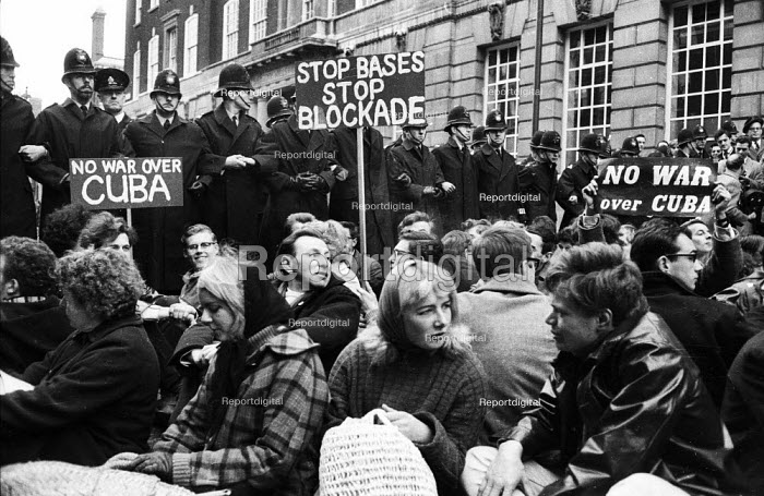 Cuban Missile Crisis. Sit down protest in Whitehall against the threat of war during the Cuban Missile Crisis 1962, London - Alex Low - 1962-10-27