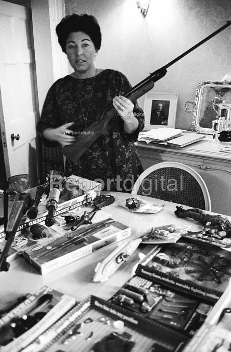 Labour Party MP Anne Kerr peace activist member of CND and opponent of the Vietnam War with toy guns and air rifle 1965 - Patrick Eagar - 1965-07-28