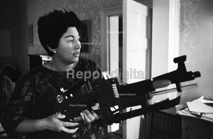Labour Party MP Anne Kerr peace activist member of CND and opponent of the Vietnam War with toy guns 1965. Topper Toys Johnny Seven - Patrick Eagar - 1965-07-28