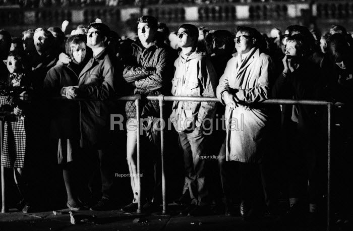 Labour Party victory in 1966 General Election. Crowds watching Labour General Election win in Trafalgar Square broadcast live on BBC TV on a screen in the Square - Patrick Eagar - 1966-03-31