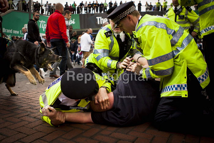 Police arresting a Millwall fan for fighting after league One victory over Millwall by Barnsley. Wembley Stadium, London - Connor Matheson - 2016-05-29