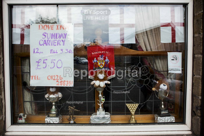 Pub window with nationalist pride, football and snooker trophies Barnsley, South Yorkshire. Sunday Carvery, The Dove Inn - Connor Matheson - 2016-06-17