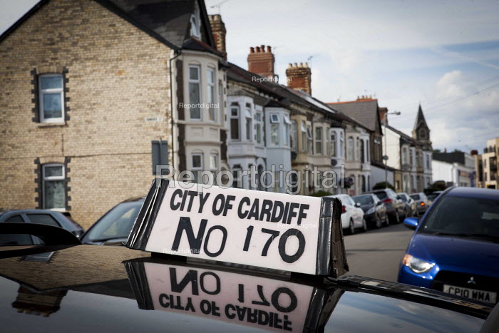 A taxi parked up on a residential street. Cardiff, South Wales. - Connor Matheson - 2016-07-31