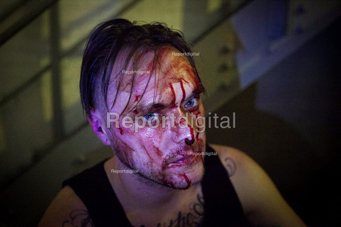 Performance artist Nick Kilby cutting his face as part of his art peice To the 330 . Fighting For Crumbs, Art Against Austerity, Gage Gallery, Sheffield, South Yorkshire - Connor Matheson - 2016-08-12