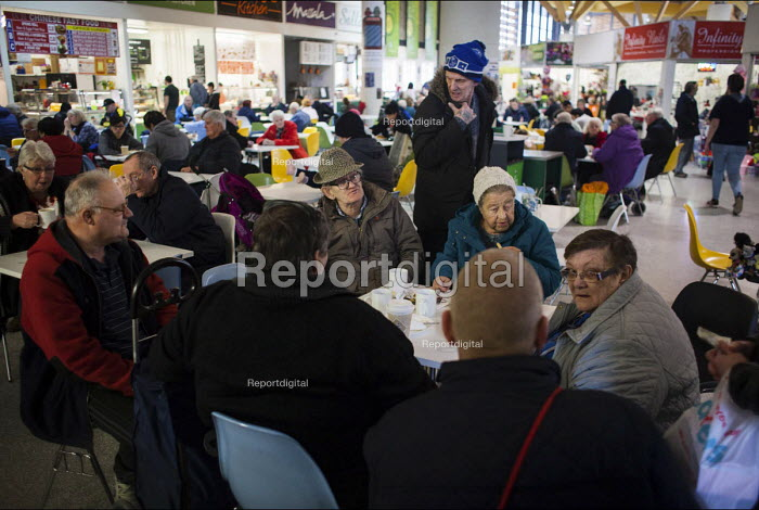 Elderly people eating in a cafe, Sheffield Moor Market. Sheffield, South Yorkshire - Connor Matheson