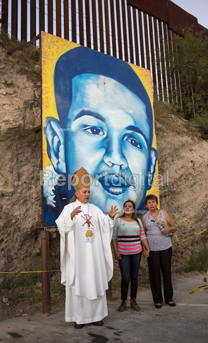 Nogales, Sonora Mexico, Nogales Bishop Jose Leopoldo Gonzalez Gonzalez dedicating a painting of 16-year-old Jose Antonio Elena Rodriguez, who was killed in October 2012 by 10 shots fired across the border by a Border Patrol agent. With Jose Antonios mother (center), the bishop dedicated the painting after saying mass below the border fence at the site where the teenager was killed - Jim West - 2016-10-08