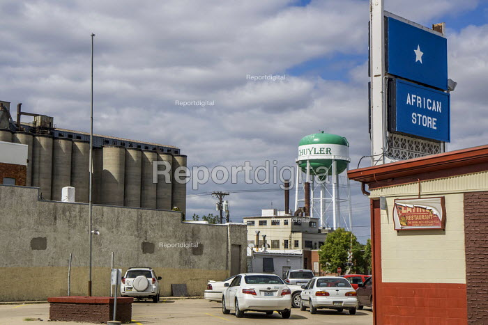 Schuyler, Nebraska, USA, Africa Store and grain silo in a small meatpacking town in Nebraska. The store customers are immigrants from Sudan and Somalia who work in the meatpacking plant - David Bacon - 2016-09-25