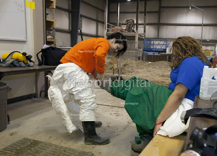 Wayne, Michigan, USA Job Corps trainees learning how to clean up hazardous materials at the Michigan Laborers Training and Apprenticeship Institute. Job Corps is a free job training program for low income youth run by the U.S. Department of Labor - Jim West - 2011-03-03
