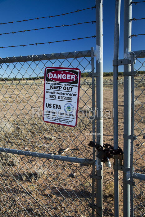 Mariano Lake, New Mexico, USA, Poisoned water for the Navajo. Sign warning of radiation danger on the site of an abandoned uranium mine, one of more than 500 abandoned mines on Navajo Nation land. This site was operated by Gulf Mineral and, later, Chevron. It has contaminated ground water so that nearby residents must rely on water supplies brought in - Jim West - 2016-10-11
